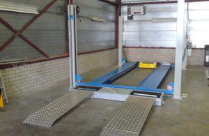 BM3010 roller brake tester in workshop in front of lift